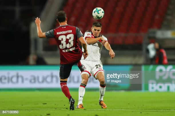 Georg Margreitter of Nuernberg und Johannes Flum of St Pauli battle for the ball during the Second Bundesliga match between 1 FC Nuernberg and FC St...