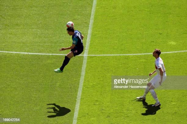 Georg Niedermeier of Stuttgart battles for the ball with Nicolai Mueller of Mainz during the Bundesliga match between VfB Stuttgart and 1 FSV Mainz...