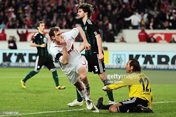 Georg Niedermeier of Stuttgart celebrates his team's first goal as Peter Pekarik Arne Friedrich and goalkeeper Andre Lenz of Wolfsburg react during...