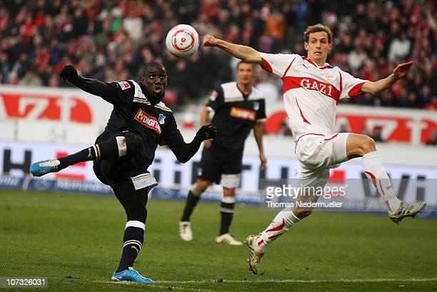 Georg Niedermeier of Stuttgart fights for the ball with Demba Ba of Hoffenheim during the Bundesliga match between VfB Stuttgart and TSG 1899...