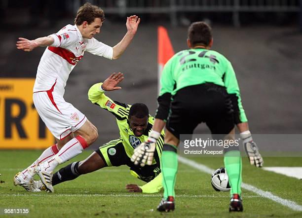 Georg Niedermeier of Stuttgart fouls Grafite of Wolfsburg during the Bundesliga match between VfB Stuttgart and VfL Wolfsburg at the MercedesBenz...
