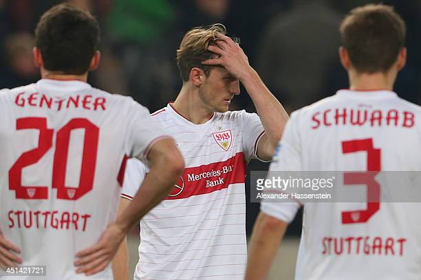 Georg Niedermeier of Stuttgart reacts with his team mates Christian Gentner and Daniel Schwaab after the Bundesliga match between VfB Stuttgart and...