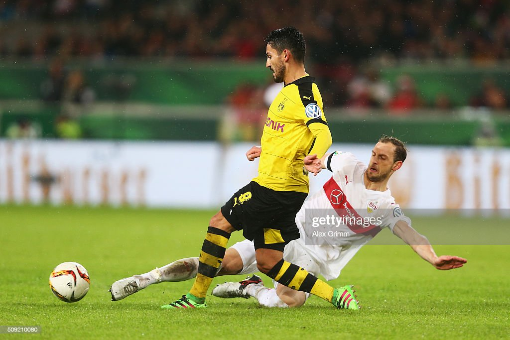 <a gi-track='captionPersonalityLinkClicked' href=/galleries/search?phrase=Georg+Niedermeier&family=editorial&specificpeople=5543183 ng-click='$event.stopPropagation()'>Georg Niedermeier</a> of Stuttgart tackles <a gi-track='captionPersonalityLinkClicked' href=/galleries/search?phrase=Ilkay+Gundogan&family=editorial&specificpeople=4956499 ng-click='$event.stopPropagation()'>Ilkay Gundogan</a> of Borussia Dortmund during the DFB Cup Quarter Final match between VfB Stuttgart and Borussia Dortmund at Mercedes-Benz Arena on February 9, 2016 in Stuttgart, Germany.
