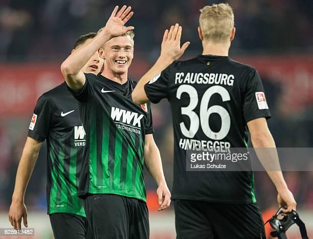 Georg Teigl of Augsburg and Martin Hinteregger shake hands after the Bundesliga match between 1 FC Koeln and FC Augsburg at RheinEnergieStadion on...