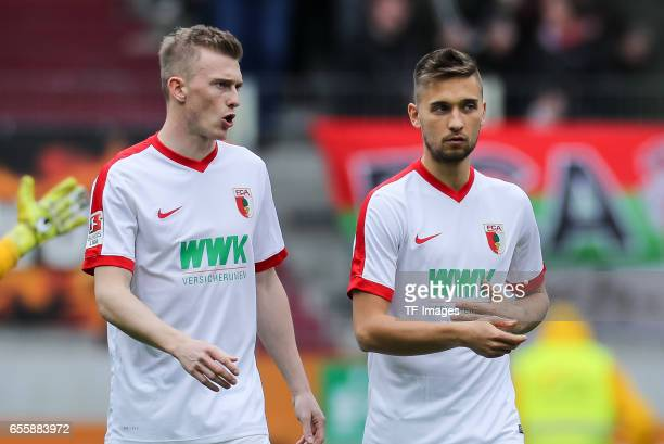 Georg Teigl of Augsburg and Moritz Leitner of Augsburg looks on during the Bundesliga match between FC Augsburg and SC Freiburg at WWK Arena on March...