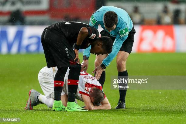 Georg Teigl of Augsburg on the ground Benjamin Henrichs of Leverkusen Referee Harm Osmers during the Bundesliga match between FC Augsburg and Bayer...