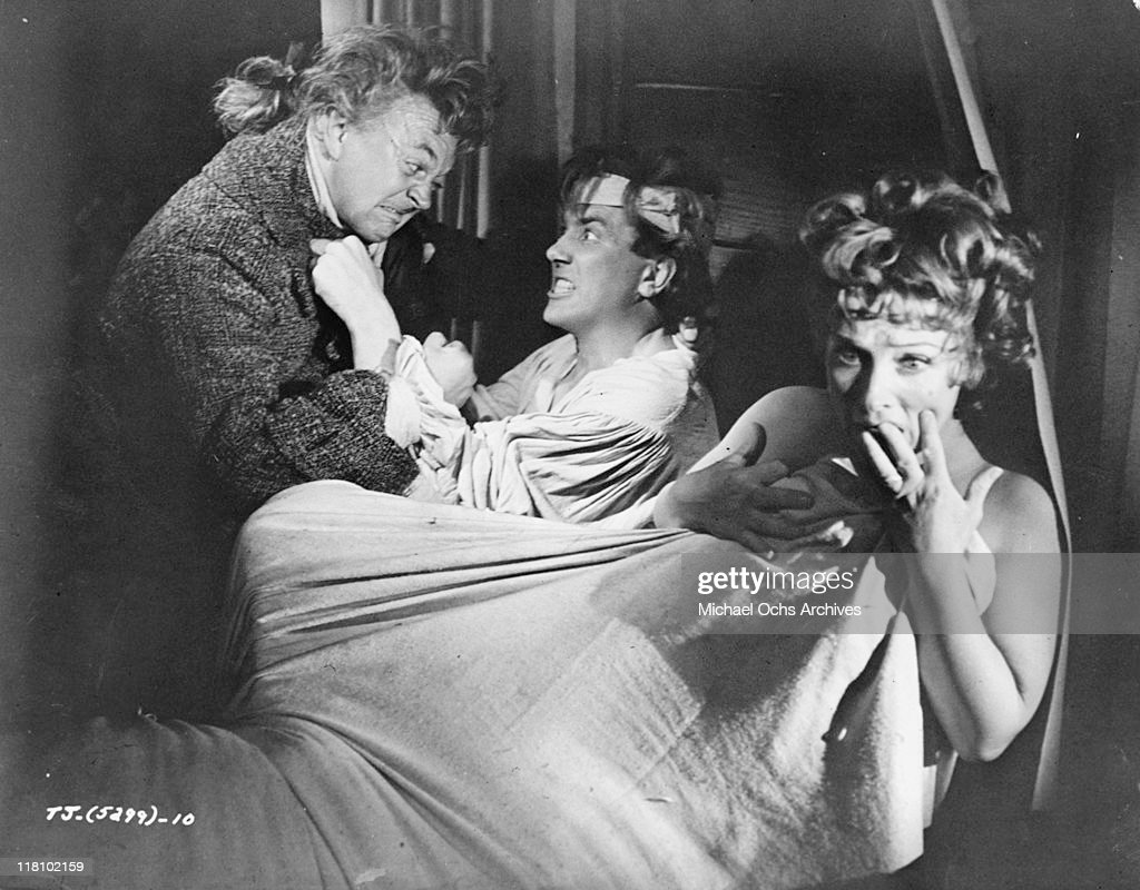 George A. Cooper fights with Albert Finney while Joyce Redman frets in a scene from the film 'Tom Jones', 1963.