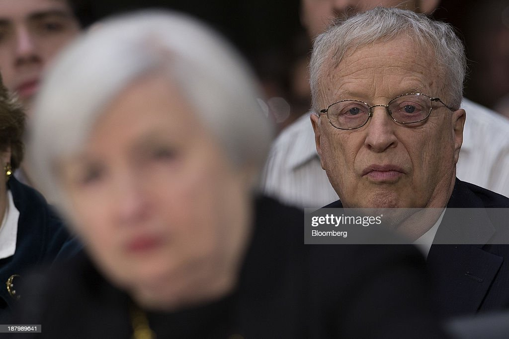 <a gi-track='captionPersonalityLinkClicked' href=/galleries/search?phrase=George+Akerlof&family=editorial&specificpeople=2684768 ng-click='$event.stopPropagation()'>George Akerlof</a>, husband of <a gi-track='captionPersonalityLinkClicked' href=/galleries/search?phrase=Janet+Yellen&family=editorial&specificpeople=2731344 ng-click='$event.stopPropagation()'>Janet Yellen</a>, right, looks on as <a gi-track='captionPersonalityLinkClicked' href=/galleries/search?phrase=Janet+Yellen&family=editorial&specificpeople=2731344 ng-click='$event.stopPropagation()'>Janet Yellen</a>, vice chairman of the U.S. Federal Reserve and U.S. President Barack Obama's nominee as chairman of the Federal Reserve, testifies during a Senate Banking Committee confirmation hearing in Washington, D.C., U.S., on Thursday, Nov. 14, 2013. Yellen said she is committed to promoting a strong economic recovery and will ensure monetary stimulus isn't removed too soon. Photographer: Andrew Harrer/Bloomberg via Getty Images