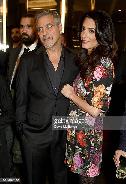 George and Amal Clooney attend the Netflix special screening and reception of The White Helmets hosted by The Clooney Foundation For Justice with...