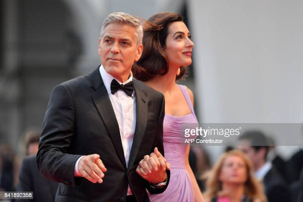George and Amal Clooney attend the premiere of the movie 'Suburbicon' presented out of competition at the 74th Venice Film Festival on September 2...