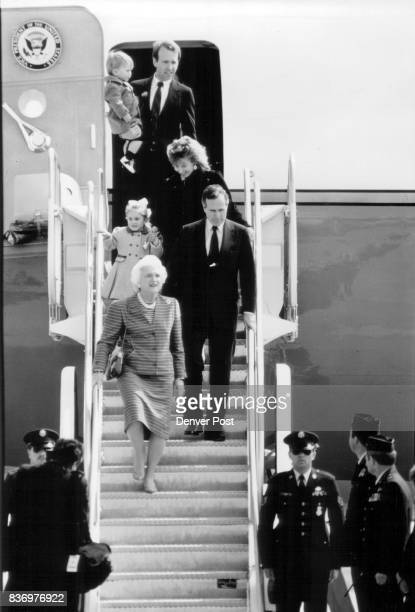 George and Barbara Bush exit Air Force Two followed by daughterinlaw Sharon Bush with granddaughter Lauren age 3 and son Neil Bush carrying grandson...