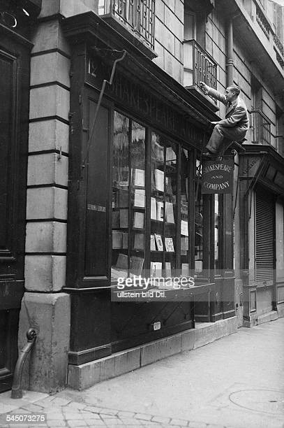 George ANTHEIL American composer *19001959 Antheil climbs to his flat above the legendary bookshop 'Shakespeare and Company' in Paris 1930