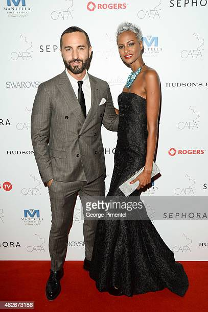 George Antonopoulos and Yasmin Warsame attends the 2nd Annual Canadian Arts And Fashion Awards held at the Fairmont Royal York Hotel on January 31...