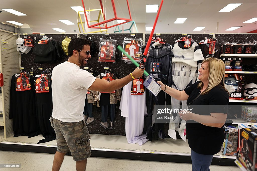 George Ascunce and Crystal Ascunce try out lightsabers as they shop in a Target store for Star Wars merchandise that went on sale on September 4 2015...