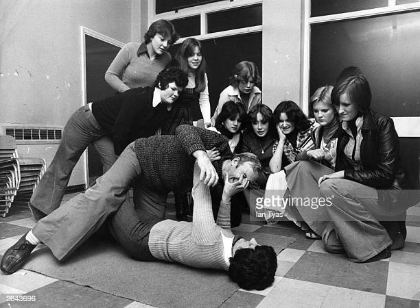 George Ashton an excommando demonstrates a self defence move to a class of girls
