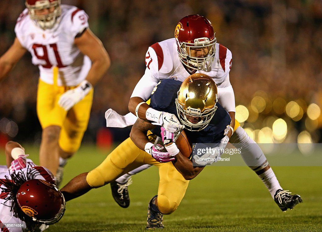 George Atkinson III #4 of the Notre Dame Fighting Irish is tackled by Josh Shaw #6 (L) and Su'a Cravens #21 of the University of Southern California Trojans at Notre Dame Stadium on October 19, 2013 in South Bend, Indiana.