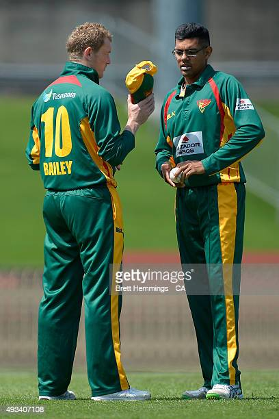 George Bailey and Clive Rose of Tasmania speak during the Matador BBQs One Day Cup match between Tasmania and Victoria at North Sydney Oval on...