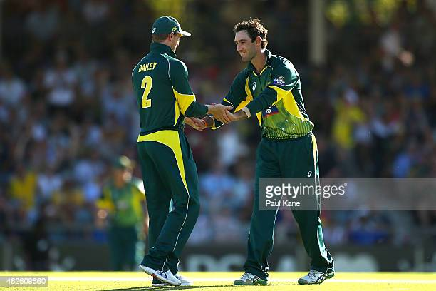 George Bailey and Glenn Maxwell of Australia celebrate the wicket of Chris Woakes of England during the final match of the Carlton Mid One Day...