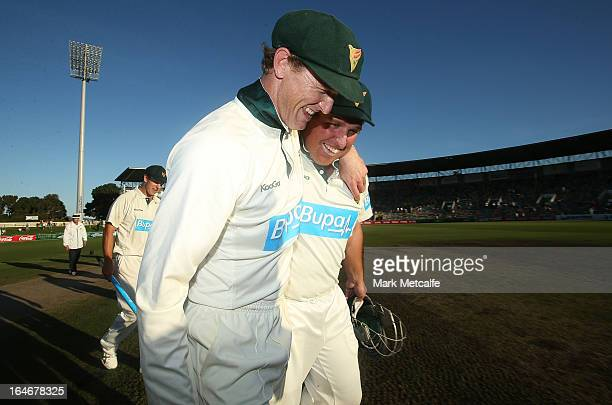 George Bailey and Mark Cosgrove of the Tigers celebrate victory in the Sheffield Shield final between the Tasmania Tigers and the Queensland Bulls at...