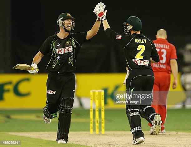 George Bailey of Australia celebrates hitting the winning runs with Cameron White during game two of the International Twenty20 series between...