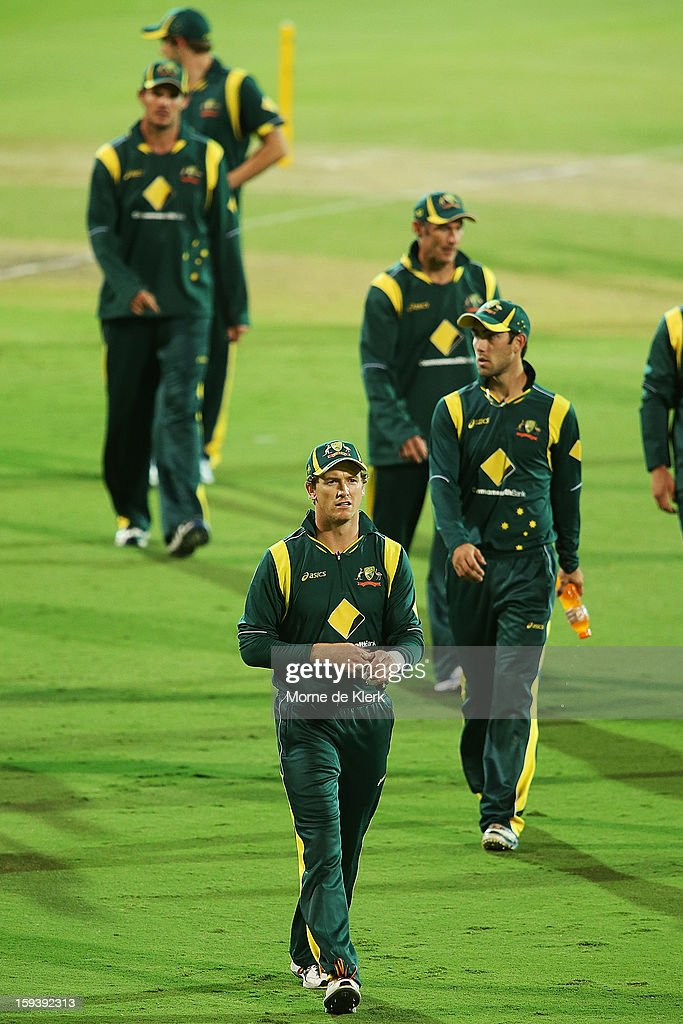 George Bailey of Australia leads the team from the field after game two of the Commonwealth Bank One Day International series between Australia and Sri Lanka at Adelaide Oval on January 13, 2013 in Adelaide, Australia.