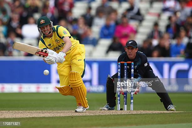 George Bailey of Australia plays to the legside as wicketkeeper Luke Ronchi of New Zealand looks on during the ICC Champions Trophy Group A match...