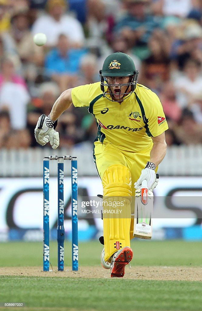 George Bailey of Australia runs after playing a shot during the third one-day international cricket match between New Zealand and Australia at Seddon Park in Hamilton on February 8, 2016.   AFP PHOTO / MICHAEL BRADLEY / AFP / MICHAEL BRADLEY