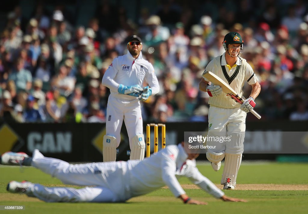 George Bailey of Australia runs between the wickets as Joe Root of England dives for the ball during day one of the Second Ashes Test Match between Australia and England at Adelaide Oval on December 5, 2013 in Adelaide, Australia.