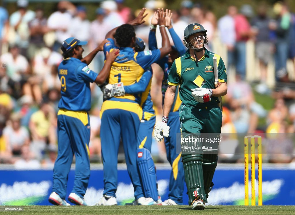 George Bailey of Australia walks from the ground after he was dismissed by <a gi-track='captionPersonalityLinkClicked' href=/galleries/search?phrase=Thisara+Perera&family=editorial&specificpeople=4884953 ng-click='$event.stopPropagation()'>Thisara Perera</a> of Sri lanka during game five of the Commonwealth Bank One Day International Series between Australia and Sri Lanka at Blundstone Arena on January 23, 2013 in Hobart, Australia.