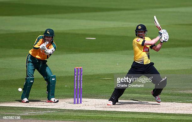 George Bailey of Sussex hits out while Chris Read of Nottinghamshire looks on during the Royal London OneDay Cup match between Sussex and...
