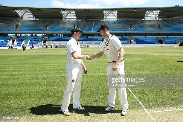 George Bailey of Tasmania and Adam Voges of Western Australia shake hands at the coin toss prior to day one of the Sheffield Shield match between...