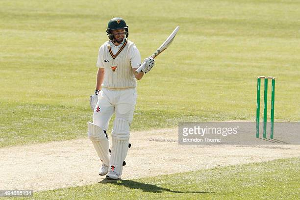 George Bailey of Tasmania celebrates scoring his half century during day three of the Sheffield Shield match between Tasmania and Western Australia...