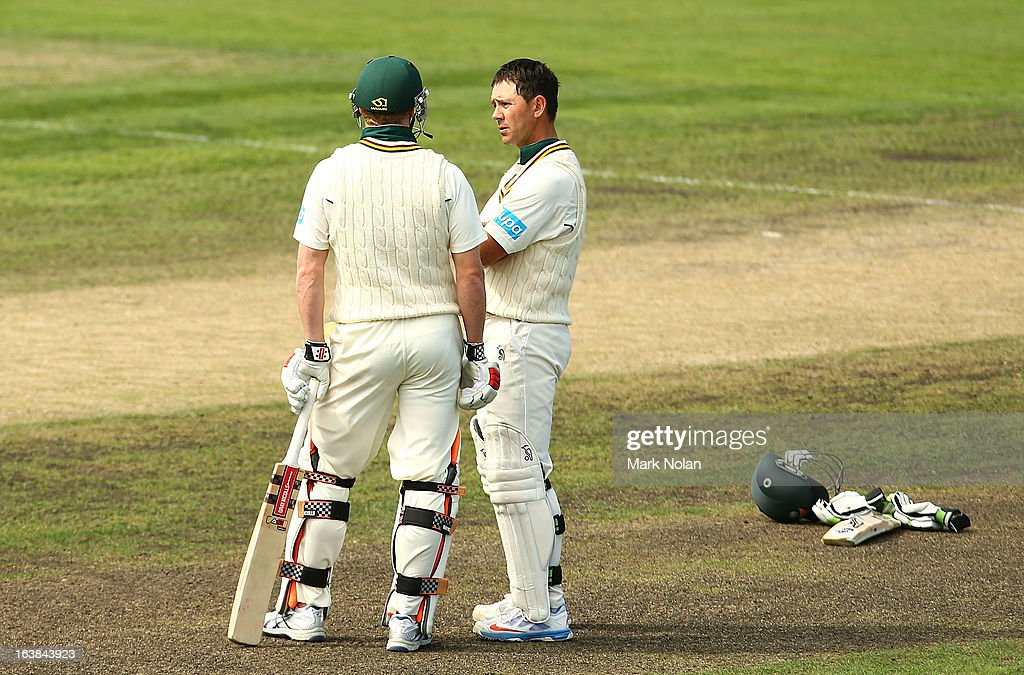 George Bailey of Tasmania chats with Ricky Ponting (R) during day four of the Sheffield Shield match between the Tasmania Tigers and the Victoria Bushrangers at Blundstone Arena on March 17, 2013 in Hobart, Australia.