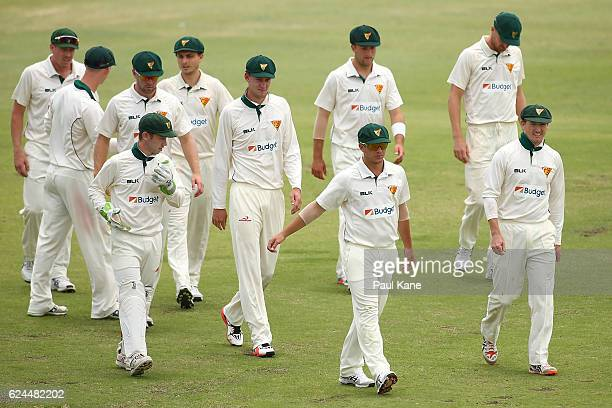 George Bailey of Tasmania leads his team from the field after dismissing Western Australia in the second innings during day four of the Sheffield...