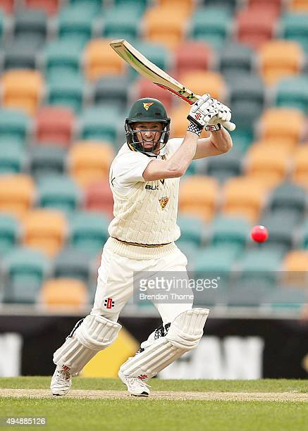 George Bailey of Tasmania plays a cover drive during day three of the Sheffield Shield match between Tasmania and Western Australia at Blundstone...
