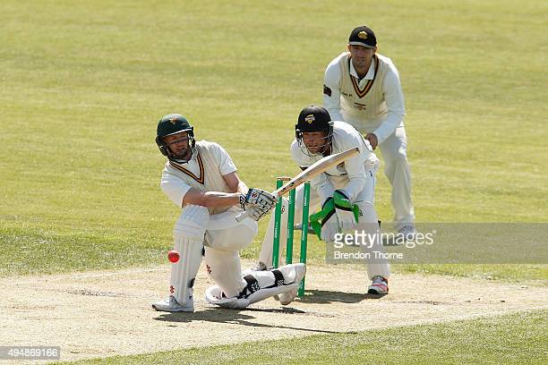 George Bailey of Tasmania plays a sweep shot during day three of the Sheffield Shield match between Tasmania and Western Australia at Blundstone...