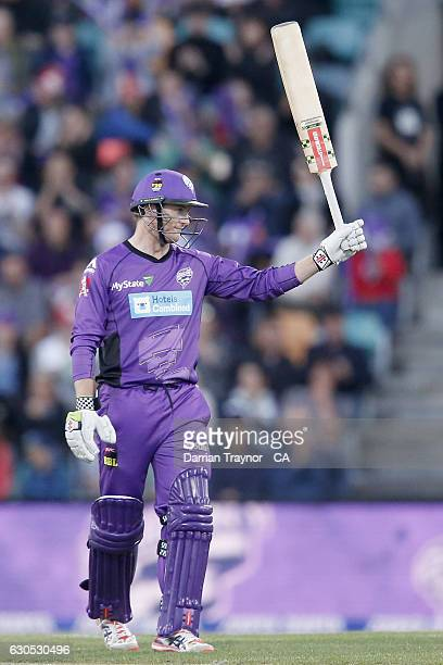 George Bailey of the Hobart Hurricanes raises his bat after scoring 50 runs during the Big Bash League match between the Hobart Hurricanes and Sydney...