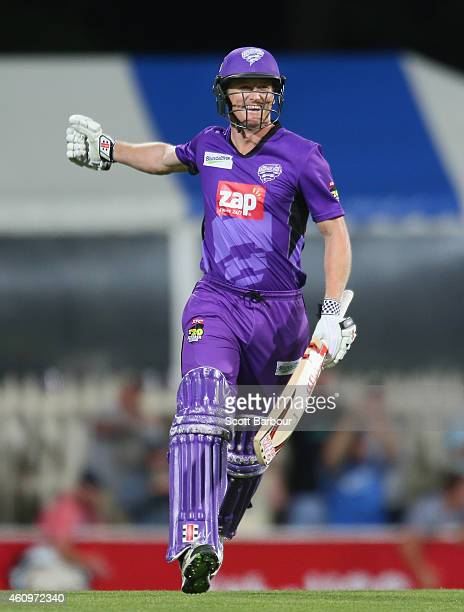 George Bailey of the Hurricanes celebrates after hitting the winning runs during the Big Bash League match between the Hobart Hurricanes and the...