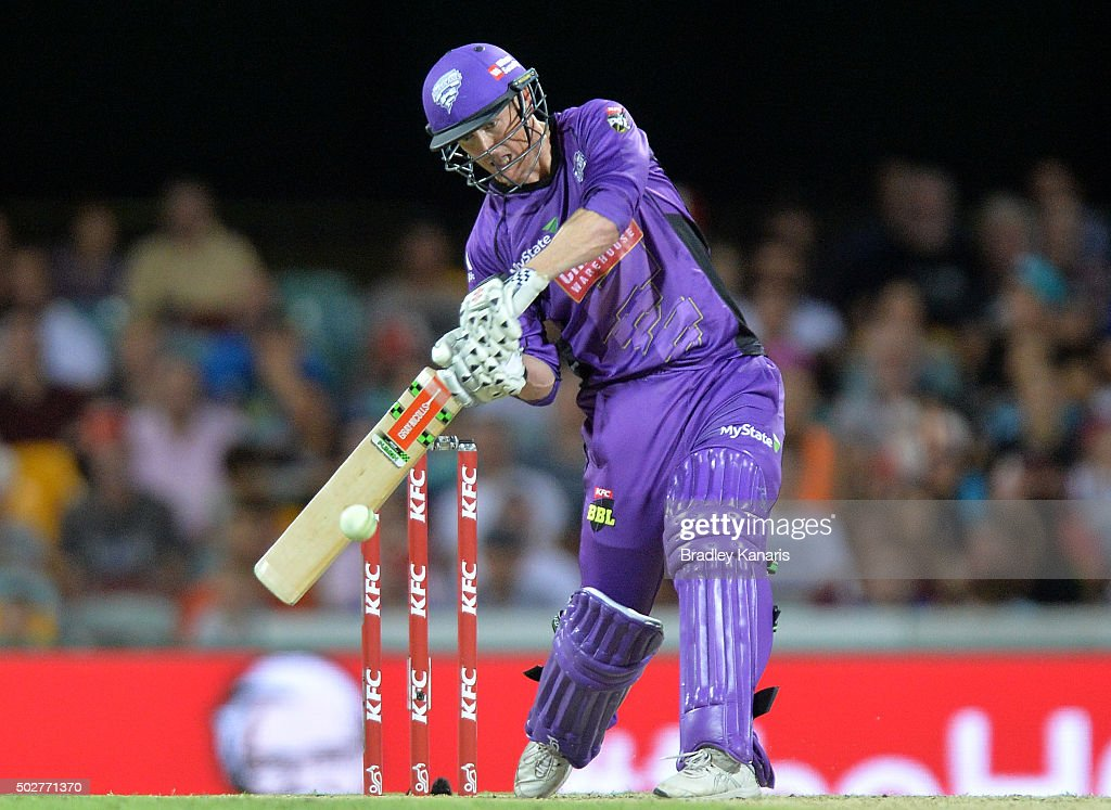 <a gi-track='captionPersonalityLinkClicked' href=/galleries/search?phrase=George+Bailey+-+Cricket+Player&family=editorial&specificpeople=9737020 ng-click='$event.stopPropagation()'>George Bailey</a> of the Hurricanes hits the ball to the boundary for a four during the Big Bash League match between the Brisbane Heat and Hobart Hurricanes at The Gabba on December 29, 2015 in Brisbane, Australia.