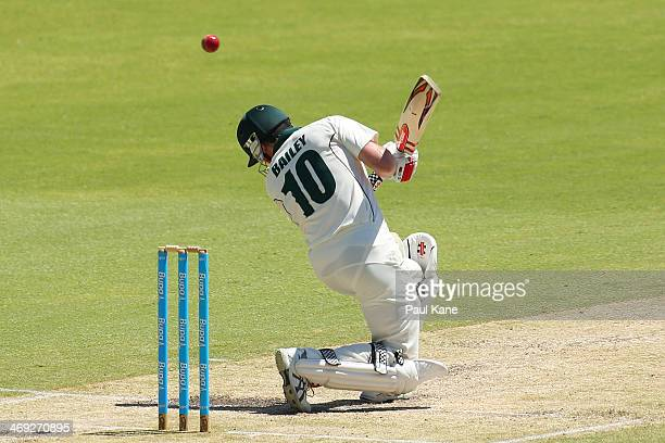 George Bailey of the Tigers avoids a high delivery from Ryan Duffield of the Warriors during day three of the Sheffield Shield match between the...