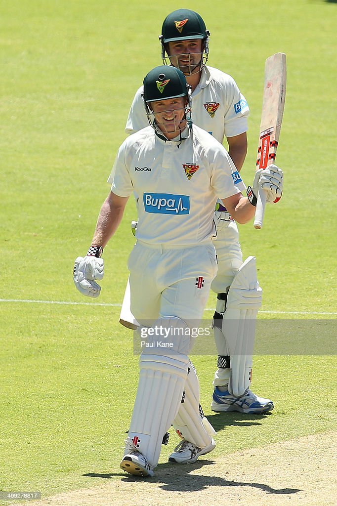 George Bailey of the Tigers celebrates his half century during day three of the Sheffield Shield match between the Western Australia Warriors and the Tasmania Tigers at the WACA on February 14, 2014 in Perth, Australia.