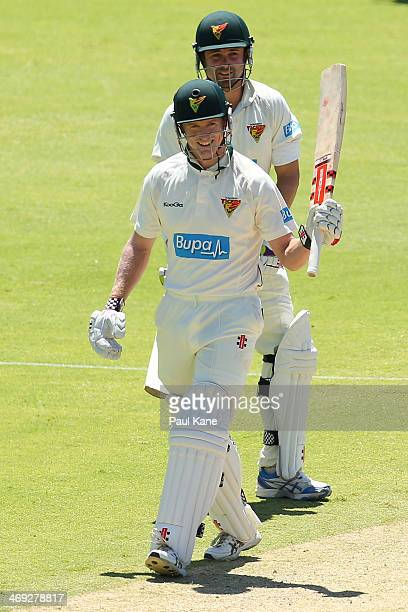 George Bailey of the Tigers celebrates his half century during day three of the Sheffield Shield match between the Western Australia Warriors and the...