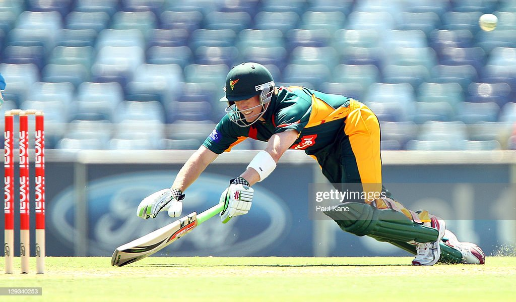 George Bailey of the Tigers dives to attempt being run out during the Ryobi One-Day Cup match between the West Australian Warriors and the Tasmanian Tigers at the WACA on October 16, 2011 in Perth, Australia.