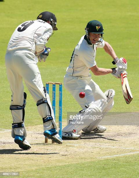 George Bailey of the Tigers edges the ball during day three of the Sheffield Shield match between the Western Australia Warriors and the Tasmania...