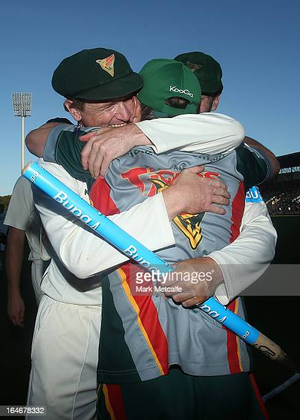 George Bailey of the Tigers embraces coach Tim Coyle after victory in the Sheffield Shield final between the Tasmania Tigers and the Queensland Bulls...