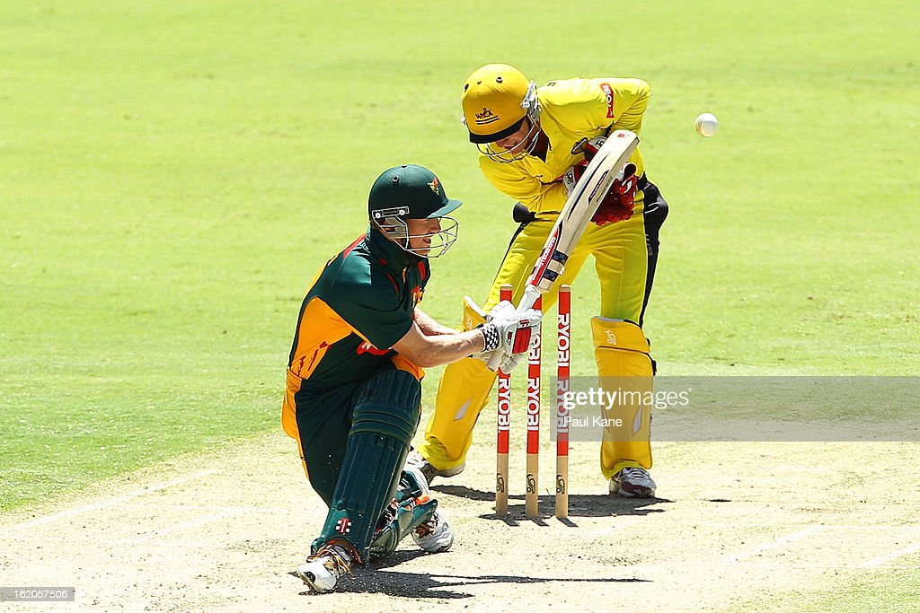George Bailey of the Tigers is dismissed by Ashton Turner of the Warriors during the Ryobi One Day Cup match between the Western Australia Warriors and the Tasmanian Tigers at the WACA on February 19, 2013 in Perth, Australia.
