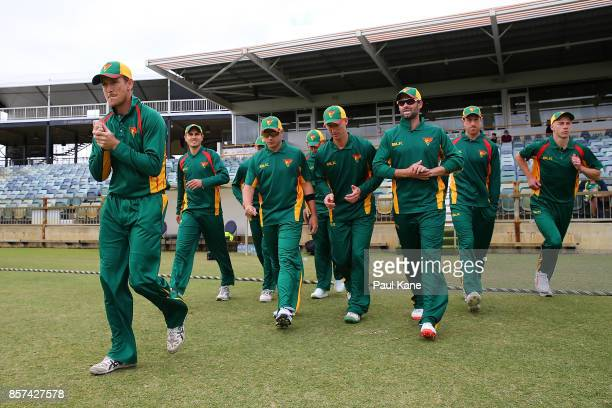 George Bailey of the Tigers leads his players onto the field during the JLT One Day Cup match between Victoria and Tasmania at WACA on October 4 2017...