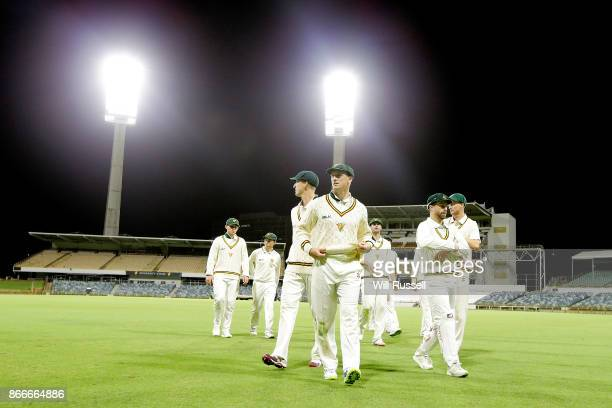 George Bailey of the Tigers leads the team off at trhe end of play on day one of the Sheffield Shield match between Western Australia and Tasmania at...