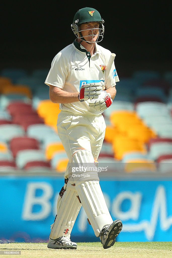George Bailey of the Tigers leaves the field after being dismissed for a duck by Ryan Harris of the Bulls during day one of the Sheffield Shield match between the Queensland Bulls and the Tasmanian Tigers at The Gabba on March 7, 2013 in Brisbane, Australia.