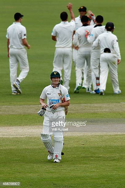 George Bailey of the Tigers leaves the field after being dismissed by Michael Klinger of the Warriors during day three of the Sheffield Shield match...